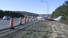 Small plane lands on Highway 5 in west Quebec on Sunday.