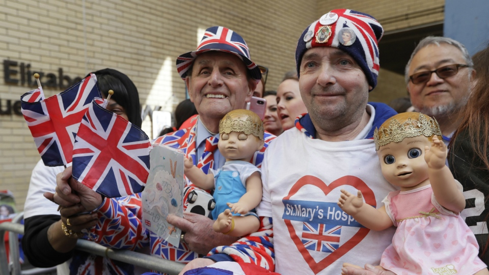 Royal fans John Loughrey, right, and Terry Hutt pose for a photo opposite the Lindo wing at St Mary's Hospital in London London, Monday, April 23, 2018. (AP Photo/Kirsty Wigglesworth)