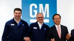 GM Korea CEO Kaher Kazem, left, GM Executive Vice President Barry Engle and Hong Young-pyo, right, a lawmaker of the ruling Democratic Party who heads the party's task force on GM Korea, pose after a tentative agreement reached between the GM Korea's management and labor union at GM Korea's factory in Bupyeong, South Korea, Monday, April 23, 2018.(Yun Tae-hyung/Yonhap via AP)