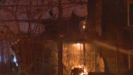 Firefighters blast flames with water at the Grey Nuns' residence on April 23, 2018