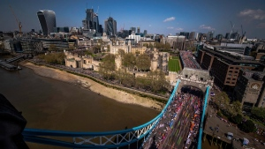 Seen from the ramparts above the roadway, runners make their way over Tower Bridge during the 2018 London Marathon, Sunday April 22, 2018. (Steven Paston/PA via AP)