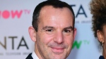 In this Jan. 23 2018 file photo, MoneySavingExpert founder Martin Lewis poses for a photo at the NTA show, in London.  (Ian West/ PA via AP, File)