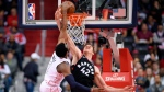 Washington Wizards guard John Wall (2) goes to the basket against Toronto Raptors center Jakob Poeltl (42) during the first half of Game 4 of an NBA basketball first-round playoff series, Sunday, April 22, 2018, in Washington. (AP Photo/Nick Wass)