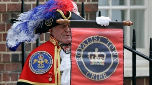 Town Crier Tony Appleton announces that the Duchess of Cambridge has given birth to a baby boy outside the Lindo wing at St Mary's Hospital in London London, Monday, April 23, 2018. (AP Photo/Tim Ireland)