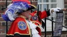 Town Crier Tony Appleton announces that the Duchess of Cambridge has given birth to a baby boy outside the Lindo wing at St. Mary's Hospital in London, Monday, April 23, 2018. (AP / Tim Ireland)
