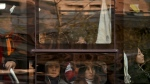 In this Nov. 28, 2017, photo, Chinese women look out of a window of a crowded bus traveling from the outskirts of the capital city during the morning rush hour, in Beijing. (AP Photo/Andy Wong)
