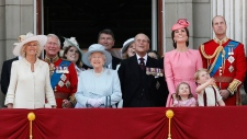 In this Saturday, June 17, 2017 file photo, members of the Royal Family from left, Camilla, the Duchess of Cornwall, Prince Charles, Princess Eugenie, Queen Elizabeth II, background Timothy Laurence, Princess Beatrice, Prince Philip, Kate, the Duchess of Cambridge, Princess Charlotte, Prince George and Prince William watch a fly past as they appear on the balcony of Buckingham Palace, after attending the annual Trooping the Colour Ceremony in London. (AP/Kirsty Wigglesworth)