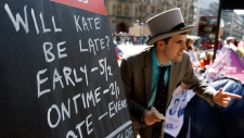 In this file photo, a bookmaker touts for trade on the pavement near to Westminster Abbey in London, Wednesday, April 27, 2011. (AP / Kirsty Wigglesworth)