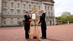 A notice is placed on an easel announcing the birth of the new Royal baby, in the forecourt of Buckingham Palace, in London, Monday, April 23, 2018. (Pool Photo via AP)