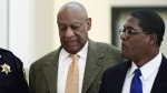 Bill Cosby, left, with his spokesman Andrew Wyatt, at the Montgomery County Courthouse in Norristown, Pa., on April 23, 2018. (Jessica Kourkounis/Pool Photo via AP)