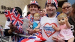 Royal fans John Loughrey, right, and Terry Hutt pose for a photo opposite the Lindo wing at St Mary's Hospital in London London, Monday, April 23, 2018. (AP/Kirsty Wigglesworth)