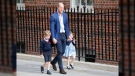 Britain's Prince William arrives with Prince George and Princess Charlotte back to the Lindo wing at St Mary's Hospital in London London, Monday, April 23, 2018. The Duchess of Cambridge gave birth Monday to a healthy baby boy — a third child for Kate and Prince William and fifth in line to the British throne. (AP Photo/Frank Augstein)