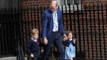 Prince William arrives with Prince George and Princess Charlotte back to the Lindo wing at St Mary's Hospital in London, Monday, April 23, 2018. (AP Photo/Kirsty Wigglesworth)
