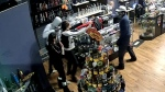 Surveillance camera still of armed robbery at Hempisphere in the 5300 block of 17 Ave SE on January 20, 2017 (CPS)