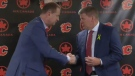 Flames GM Brad Treliving and head coach Bill Peters shake hands on April 23, 2018 during the announcement that Peters had been hired as the team's next coach