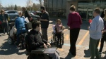 People with physical disabilities protested at the Brossard offices of Health Minister Gaetan Barrette on Monday April 23, 2018