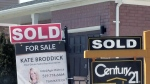 Sold signs are seen outside a home in Brantford on Friday, April 20, 2018.