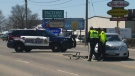 Police investigate after a cyclist was hit by a vehicle on Victoria Street North in Kitchener on Sunday, April 22, 2018.