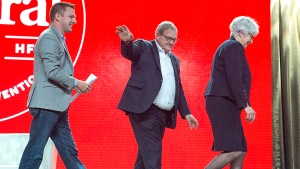 MP Francis Drouin, left, follows Agriculture Minister Lawrence MacAulay and his wife Francis, after moderating a talk about their rural life experience, at the federal Liberal national convention in Halifax on Saturday, April 21, 2018. (THE CANADIAN PRESS/Andrew Vaughan)