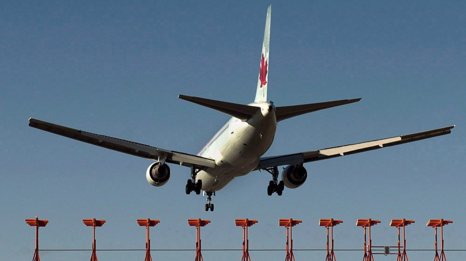 An Air Canada passenger jet lands at Halifax Stanfield International Airport in Halifax on Monday, Jan. 21, 2013. (THE CANADIAN PRESS/Andrew Vaughan)