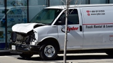 A van with a damaged front-end is shown on a sidewalk after a van mounted a sidewalk crashing into a number of pedestrians in Toronto on Monday, April 23, 2018. THE CANADIAN PRESS/Frank Gunn
