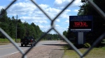 A sign welcomes visitors at the entrance to the Chalk River Laboratories in Chalk River, Ont., on Monday, July 9, 2012. (THE CANADIAN PRESS/Sean Kilpatrick)