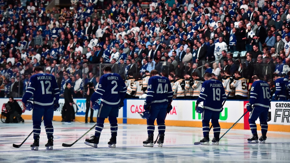 Players and fans stand for a moment of silence, after nine people died and 16 others were injured when a van mounted a sidewalk and struck multiple pedestrians along a stretch of one of Toronto's busiest streets, before first period NHL round one playoff hockey action against the Boston Bruins in Toronto on Monday, April 23, 2018. (THE CANADIAN PRESS/Frank Gunn)