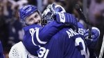 Toronto Maple Leafs centre Tyler Bozak and goaltender Frederik Andersen celebrate their win over the Boston Bruins in NHL round one playoff hockey action in Toronto on Monday, April 23, 2018. THE CANADIAN PRESS/Frank Gunn