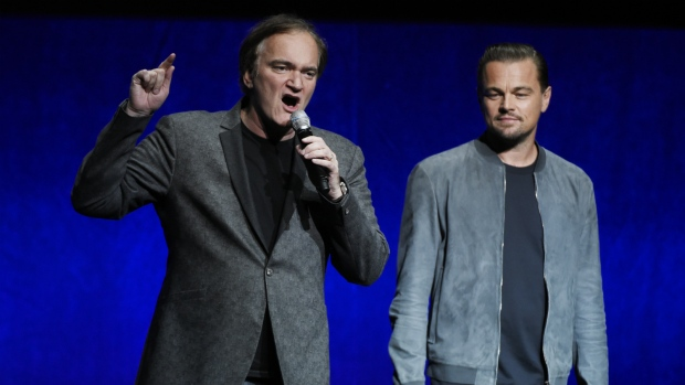 Quentin Tarantino, left, writer/director of the upcoming film 'Once Upon a Time in Hollywood,' discusses the project as cast member Leonardo DiCaprio looks on during the Sony Pictures Entertainment presentation at CinemaCon 2018, the official convention of the National Association of Theatre Owners, at Caesars Palace in Las Vegas on Monday, April 23, 2018. (Chris Pizzello/Invision)