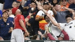 Los Angeles Angels first baseman Albert Pujols, left, catches the foul ball of Houston Astros' Alex Bregman during the seventh inning of a baseball game in Houston on Monday, April 23, 2018. (AP Photo/Eric Christian Smith)