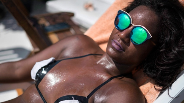 Woman lounges in the sun in Brazil