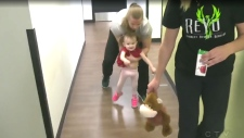 Girl learning to walk