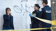 Toronto police talk to a woman after a van mounted a sidewalk crashing into a number of pedestrians in Toronto on Monday, April 23, 2018. (Nathan Denette / THE CANADIAN PRESS)