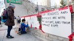 People sign a memorial in Toronto after a van mounted a sidewalk crashing into a number of pedestrians on Monday, April 23, 2018. THE CANADIAN PRESS/Nathan Denette