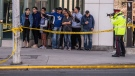 Emergency services close Yonge Street in Toronto after a van mounted a sidewalk crashing into a number of pedestrians on Monday, April 23, 2018. (Aaron Vincent Elkaim / THE CANADIAN PRESS)