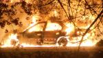 A car burns during a barn fire in Pitt Meadows, B.C. early Tuesday morning.