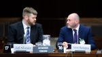 Jeff Silvester, left, and Zackary Massingham of AggregateIQ appear as witnesses at the commons privacy and ethics committee in Ottawa on Tuesday, April 24, 2018. THE CANADIAN PRESS/Sean Kilpatrick