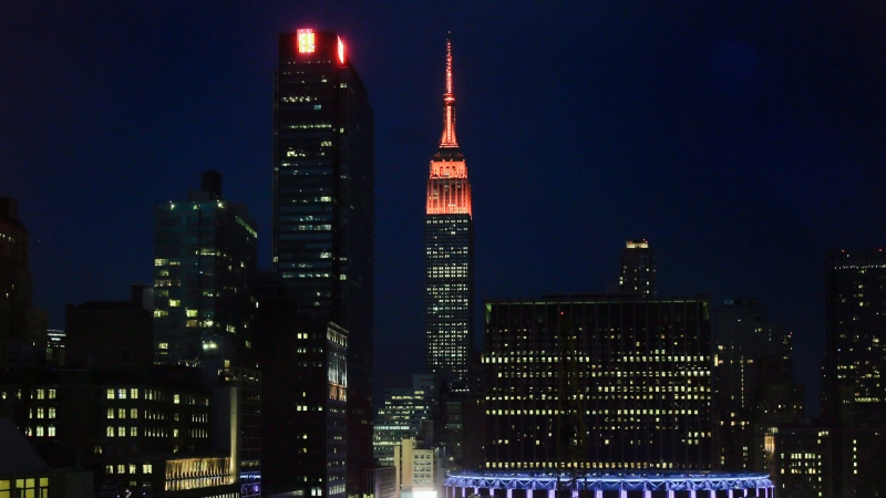In this June 1, 2016, file photo, orange lights illuminate the Empire State Building in recognition of Gun Violence Awareness Month in New York. (AP Photo/Julie Jacobson, File)