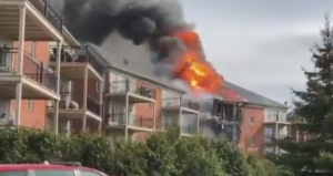 Residential fire destroys apartment building in Brossard | CTV News