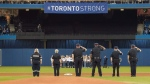 First responders who helped during Monday's deadly van rampage participate in the singing of the national anthem prior to the start of the Blue Jays American League MLB baseball game against the Boston Red Sox in Toronto on Tuesday April 24, 2018. THE CANADIAN PRESS/Fred Thornhill