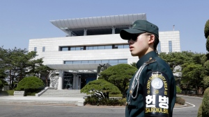 A South Korean soldier stands outside of the Peace House, the venue for the planned summit between South Korean President Moon Jae-in and North Korean leader Kim Jong Un on April 27, during a press tour at the southern side of the Panmunjom in the Demilitarized Zone, South Korea on April 18, 2018. (AP Photo/Lee Jin-man)