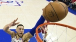 Philadelphia 76ers' Ben Simmons, left, shoots over Miami Heat's Hassan Whiteside, right, during the first half in Game 5 of a first-round NBA basketball playoff series in Philadelphia on Tuesday, April 24, 2018. (AP Photo/Chris Szagola)