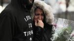 A woman cries at a vigil on Yonge Street in Toronto, Tuesday, April 24, 2018. THE CANADIAN PRESS/Galit Rodan