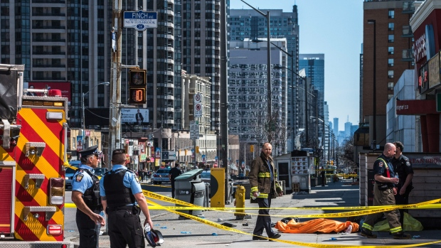 A body lies covered on the sidewalk in Toronto after a van mounted a sidewalk crashing into a number of pedestrians on Monday, April 23, 2018. THE CANADIAN PRESS/Aaron Vincent Elkaim