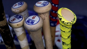 Los Angeles Dodgers' Joc Pederson's bat, right, in the dugout in New York, on Aug. 4, 2017. (Julie Jacobson / AP)