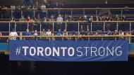 "A ""Toronto Strong"" banner is shown in centre field before the start of American League MLB baseball game between the Toronto Blue Jays and the Boston Red Sox in Toronto on Tuesday April 24, 2018. THE CANADIAN PRESS/Fred Thornhill"