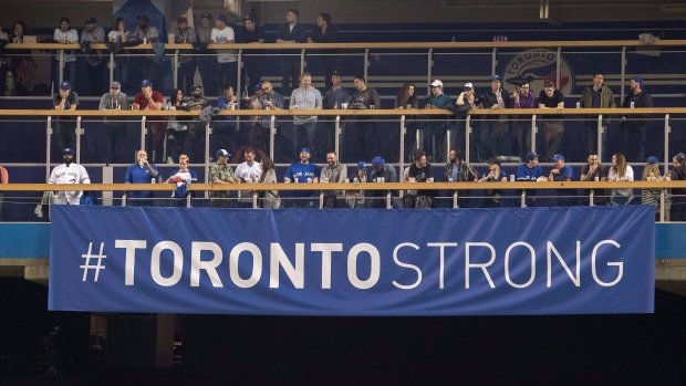 """A """"Toronto Strong"""" banner is shown in centre field before the start of American League MLB baseball game between the Toronto Blue Jays and the Boston Red Sox in Toronto on Tuesday April 24, 2018. THE CANADIAN PRESS/Fred Thornhill"""