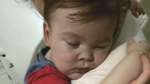 Alfie Evans cuddles his mother Kate James at Alder Hey Hospital, Liverpool, England, on April 23, 2018. (Alfies Army Official via AP)