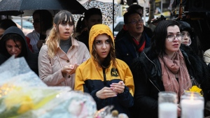 People sing Amazing Grace at a vigil on Yonge Street in Toronto, Tuesday, April 24, 2018. Ten people were killed and 14 were injured in Monday's deadly attack in which a van struck pedestrians in northern Toronto. THE CANADIAN PRESS/Galit Rodan