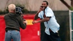 Rapper Meek Mill, right, leaves the State Correctional Institution in Chester, Pa., Tuesday, April 24, 2018. The rapper walked out of prison Tuesday after Pennsylvania's highest court ordered him freed while he appeals decade-old gun and drug convictions. Following a five-month campaign by his supporters to get him out, the state Supreme Court directed a Philadelphia judge who had jailed him to immediately issue an order releasing him on unsecured bail. (David Swanson /The Philadelphia Inquirer via AP)